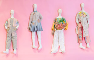 Four mannequins with outfits