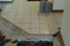 Breaking home tile to fix a leak