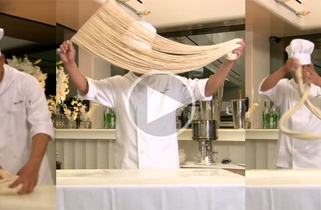 This master chef makes 100's of noodles out of a thick roll of dough. AMAZING!