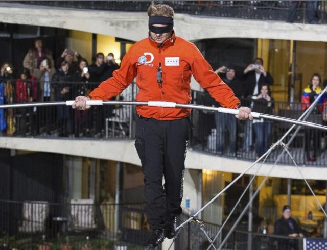 Daredevil Walks Across A Tightrope Between Skyscrapers In Chicago!