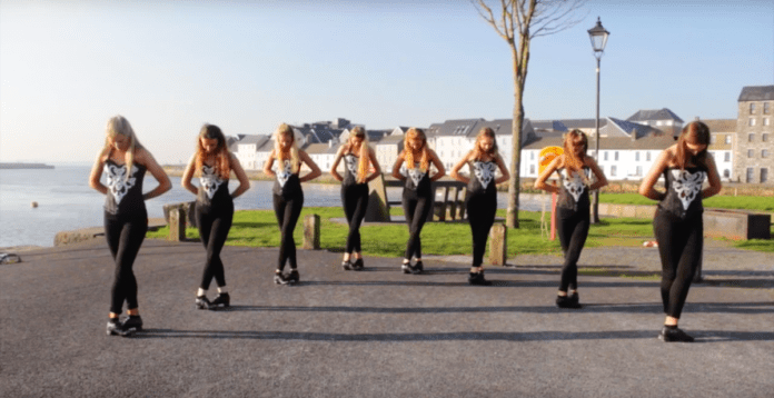 8 girls line up on the street – but look closer as the unexpected suddenly happens 3