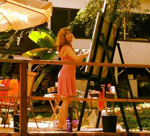 Angela painting outside