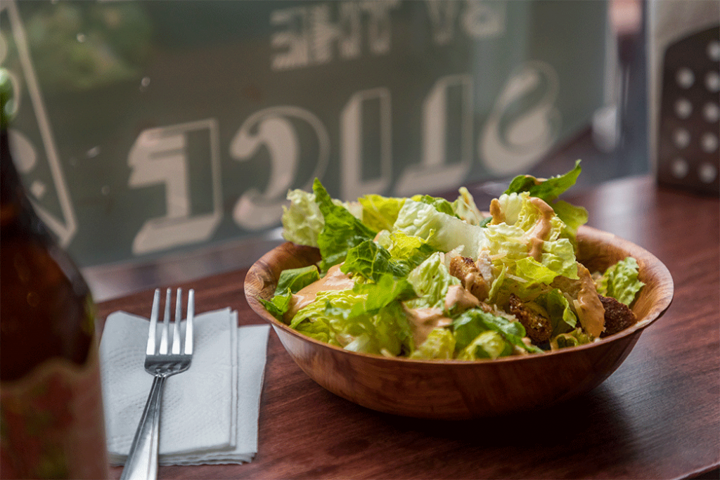 Ceasar salad in a wooden bowl at Rodeos Pizzeria and Saladeria in Klamath Falls, Oregon.
