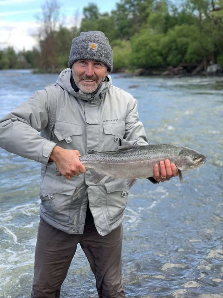 Lifetime Klamath Falls resident, Russ Ovgard, poses with an early spring fish from the Link River, one of more than a dozen fish landed that day. The Link River is catch and release only.