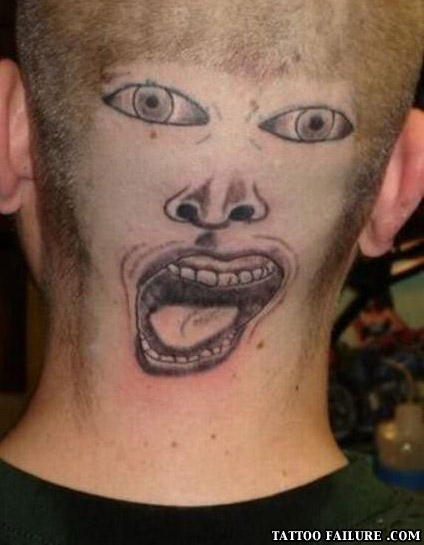 crazy face on back of head tattoo