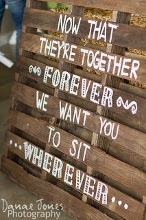 pallet seating sign at wedding