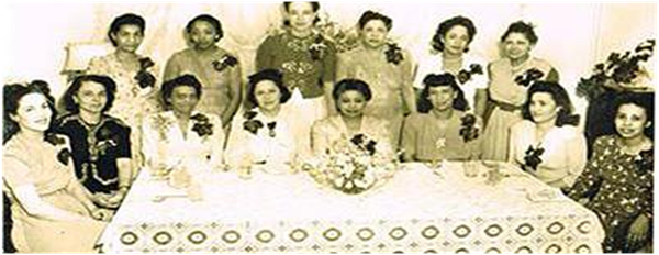 (standing left to right Sorors Elizabeth M. Pindle, Geneva Harper Puryear, Mary Bullock Kidd, Lenora P. Williams, Josephine Brown Dutton, Jeanette Harrison Anderson; seated left to right Soror Lena R. Perry Martin, Louise B. Davis, Maudestine D. Manning, Lillian P. Smith (in the middle in front of flowers is Marguerite Adams former South-Atlantic Regional Director) Doris Orr, Julia Mason Moses, Lois Taylor not pictured are Sorors Anne Cooke, Margaret Gillespie Cooper, Sadie Harvey)