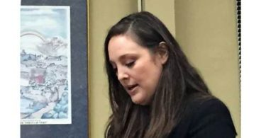 Melanie Victor, from Tennessee, speaks in opposition to kratom ban under discussion at Board of Alderment meeting.