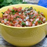 This salsa called Pico de Gallo is also called salsa fresca. It is served with most Mexican dishes. I have grown to love this salsa over my eggs for breakfast!