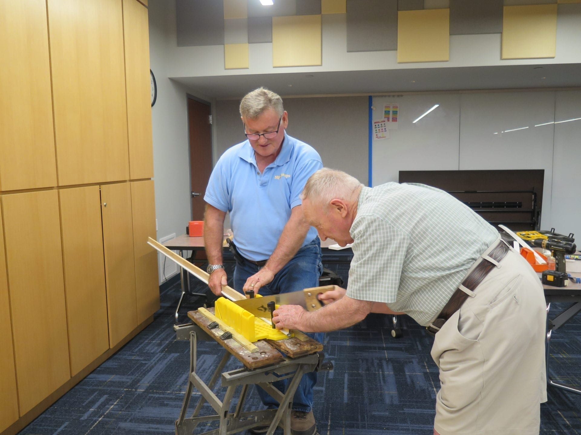 Brian showing a student how to cut weather stripping
