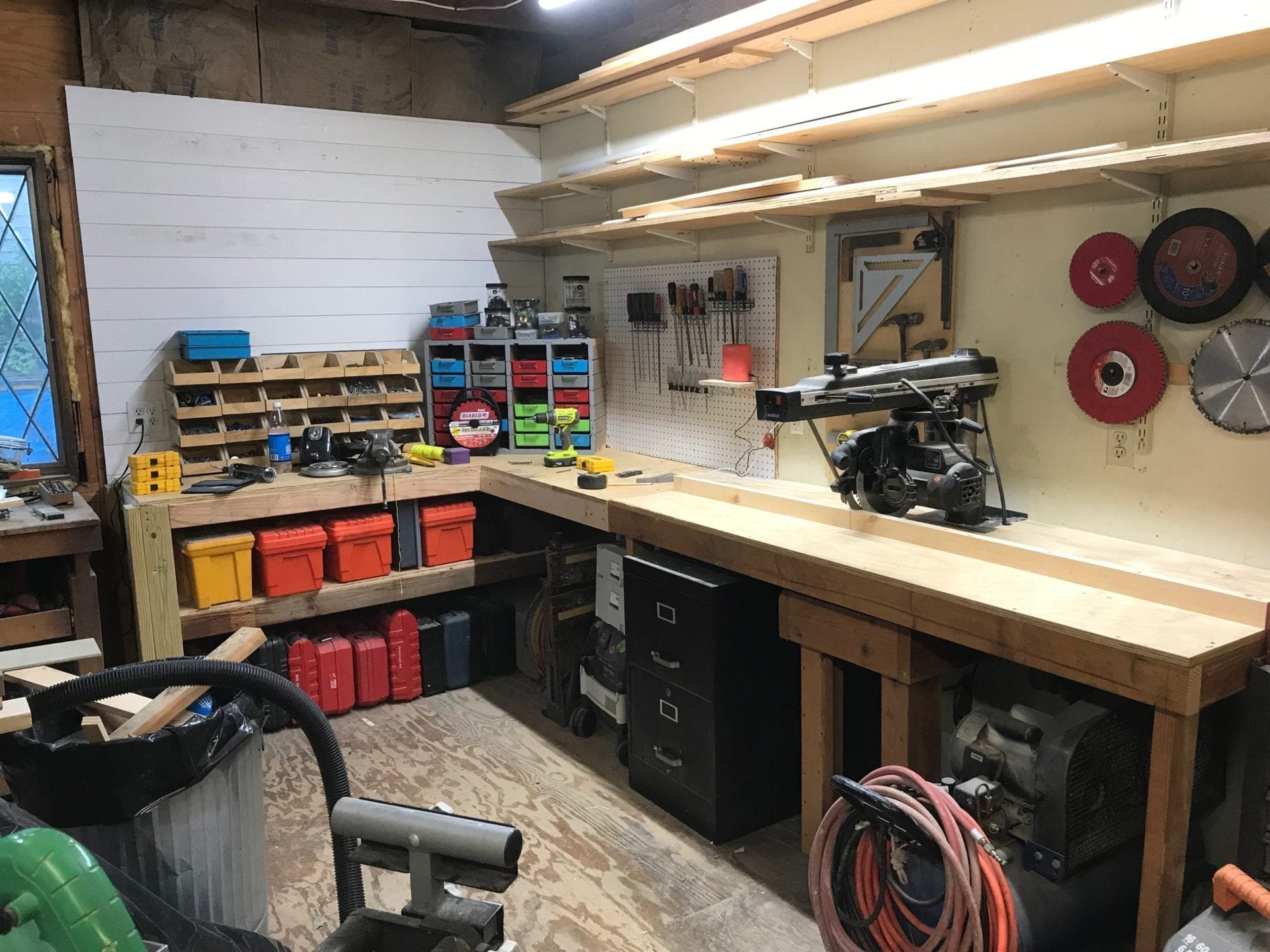 tools, screws, cabinets and shelving space in newly renovated workshop