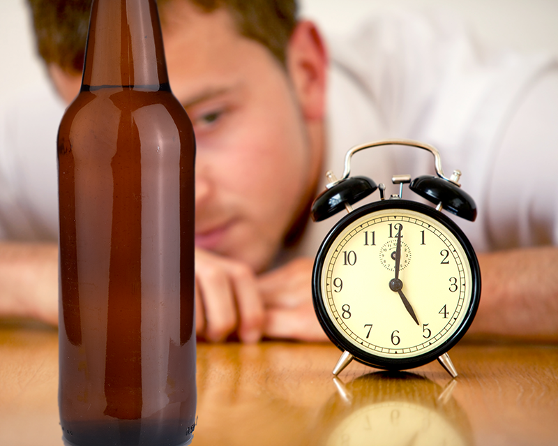 Man watching home brewing timeline and fermentation times