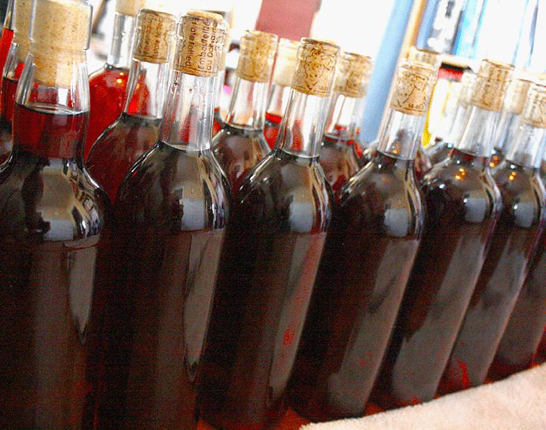 Man Sweetening A Wine Before Bottling