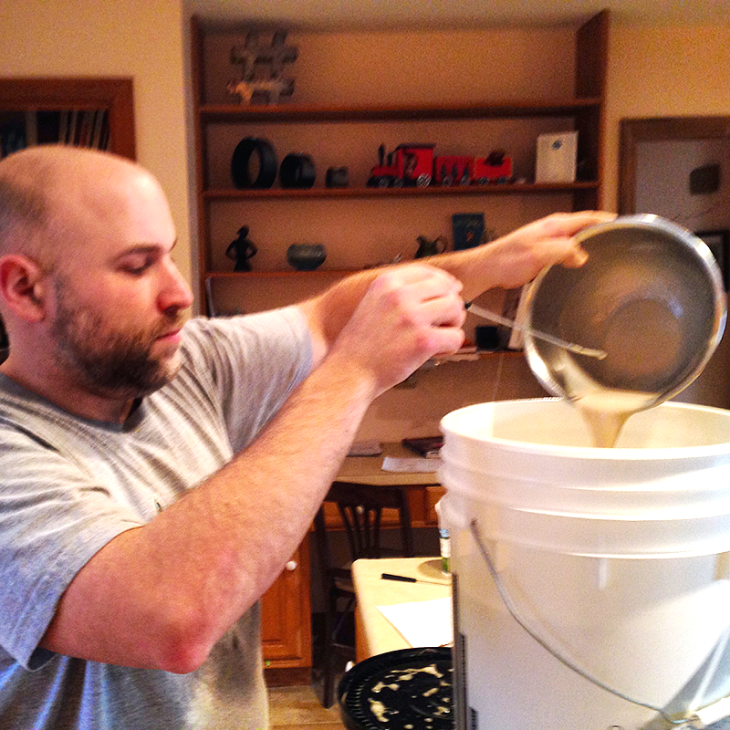 Homebrewer Adding Beer Brewing Additives