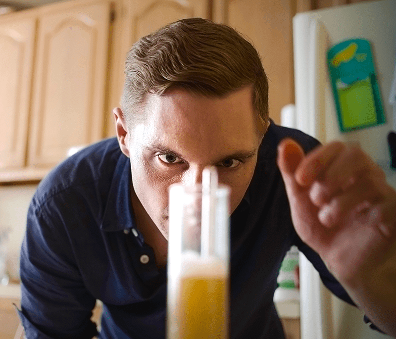 Homebrewer Learning How To Use A Hydrometer