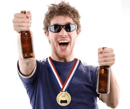 Man Holding Beer Bottles With Gold Medal