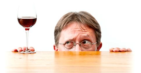 Man Affraid of Alcohol in Wine.