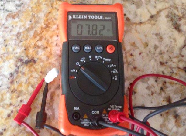 Multimeter for checking sensor resistance.