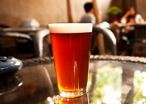 Glass Of Amber Rye Ale On Table