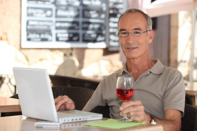 Man with Wine at Computer