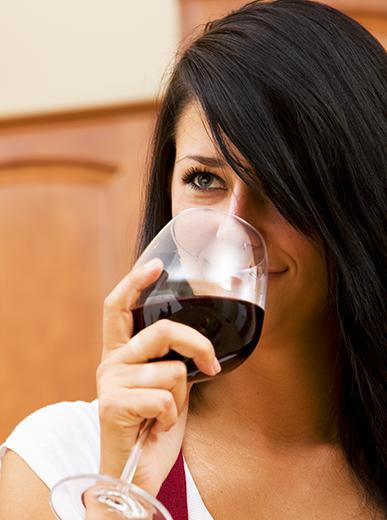 Woman Sampling Homemade Wine