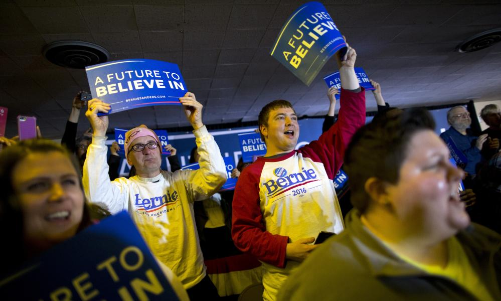 Supporters cheer for Democratic presidential candidate Sen. Bernie Sanders, I-Vt., at a campaign event, Saturday, Jan. 23, 2016, in Clinton, Iowa. (AP Photo/Jae C. Hong)