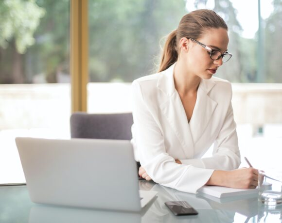 thoughtful businesswoman taking notes in notebook in bright 3756693 scaled