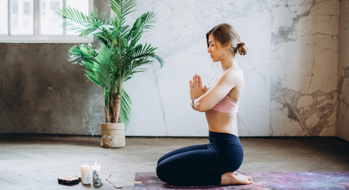 woman meditating with candles and incense 3822864 scaled