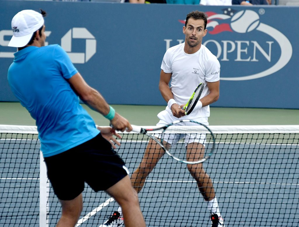 Head to head at the net: Marcelo Arevalo of Spain vs Giraldo Santiago of Colombia (seeded 18) in first round of the Qualifying Matches © 2016 Karen Rubin/news-photos-features.com