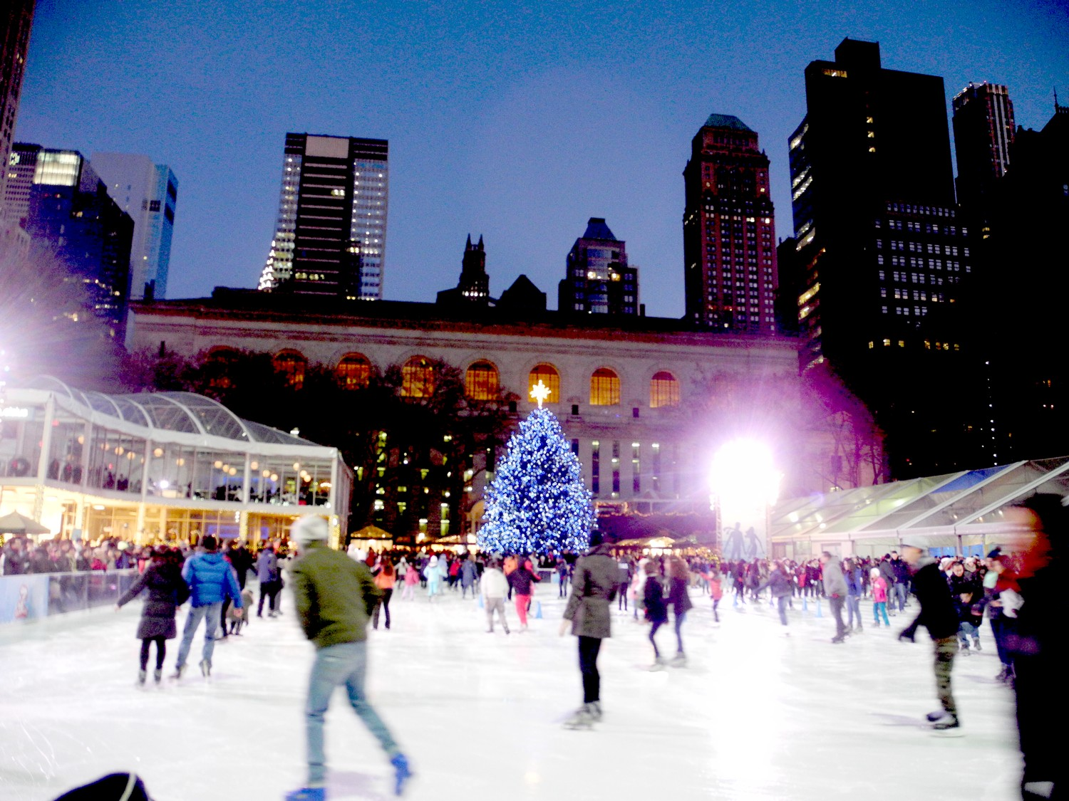 Bryant Park with its Christmas tree, skating rink, holiday market and cafes has become a warm and wonderful holiday venue © 2016 Karen Rubin/goingplacesfarandnear.com