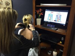 Noninvasive scans are completed at an initial chiropractic visit to Frain Family Chiropractic.
