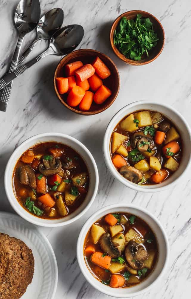 easy pantry staple recipe of bowls of vegetables stew filled with mushrooms, potatoes and carrots