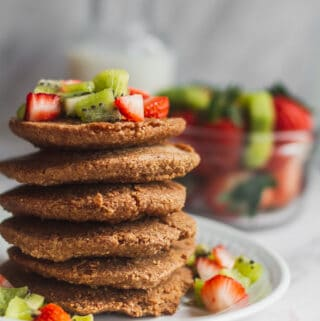 oatmeal pancakes topped with strawberries and kiwi