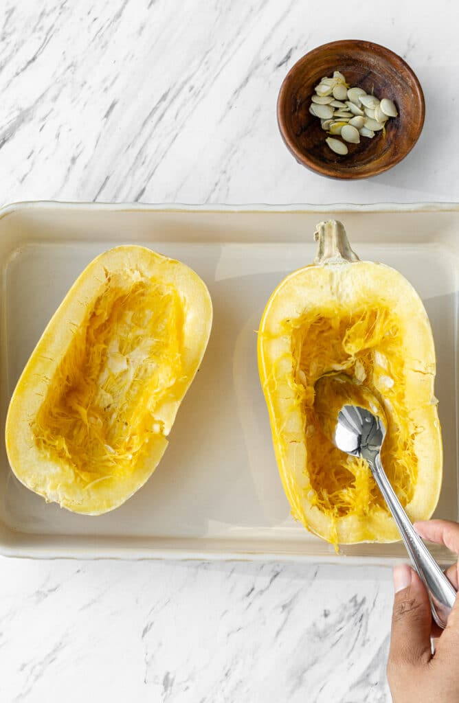 removing seeds from squash in pan