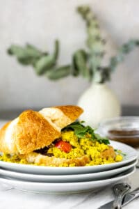 tofu scramble with tomatoes, spinach, vegan croissant, and fig preserve