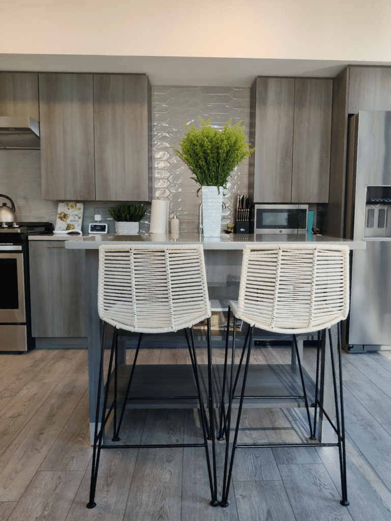 gray back splash with kitchen island and counter stools