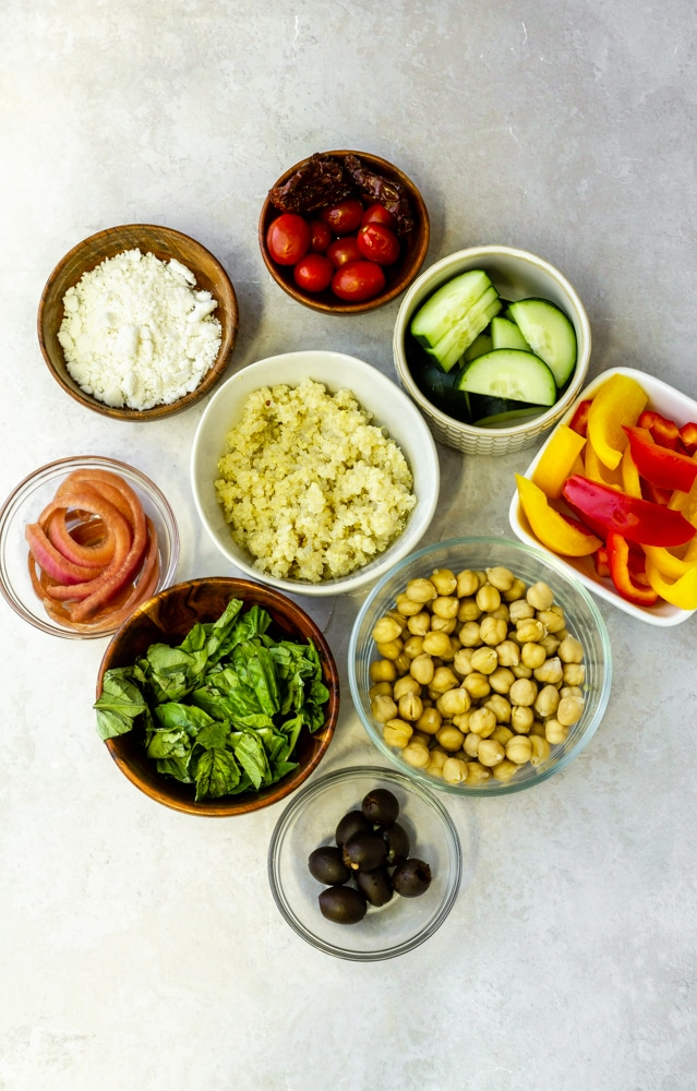 quinoa, chickpeas, cucumber, bell peppers, red onion, cherry tomatoes, feta cheese, olives, basil