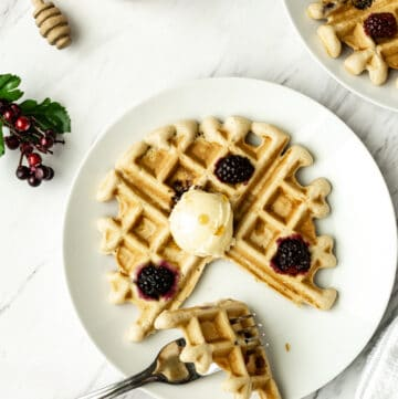 vegan blackberry waffles with vegan butter, maple syrup, berries