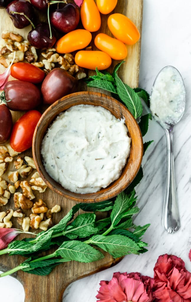 a bowl of whipped vegan feta with maple syrup and thyme