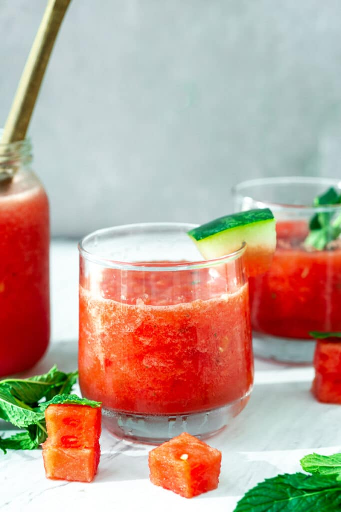 best watermelon slushie with mint, basil, in glass cups