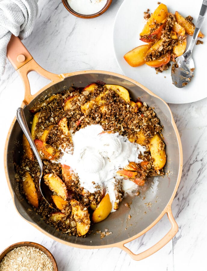 peach crisp recipe in always pan and white plate