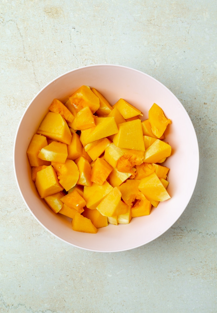 cubed squash in a pink bowl