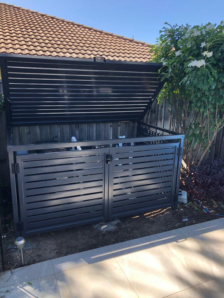 pool pump enclosure lid open with gas struts