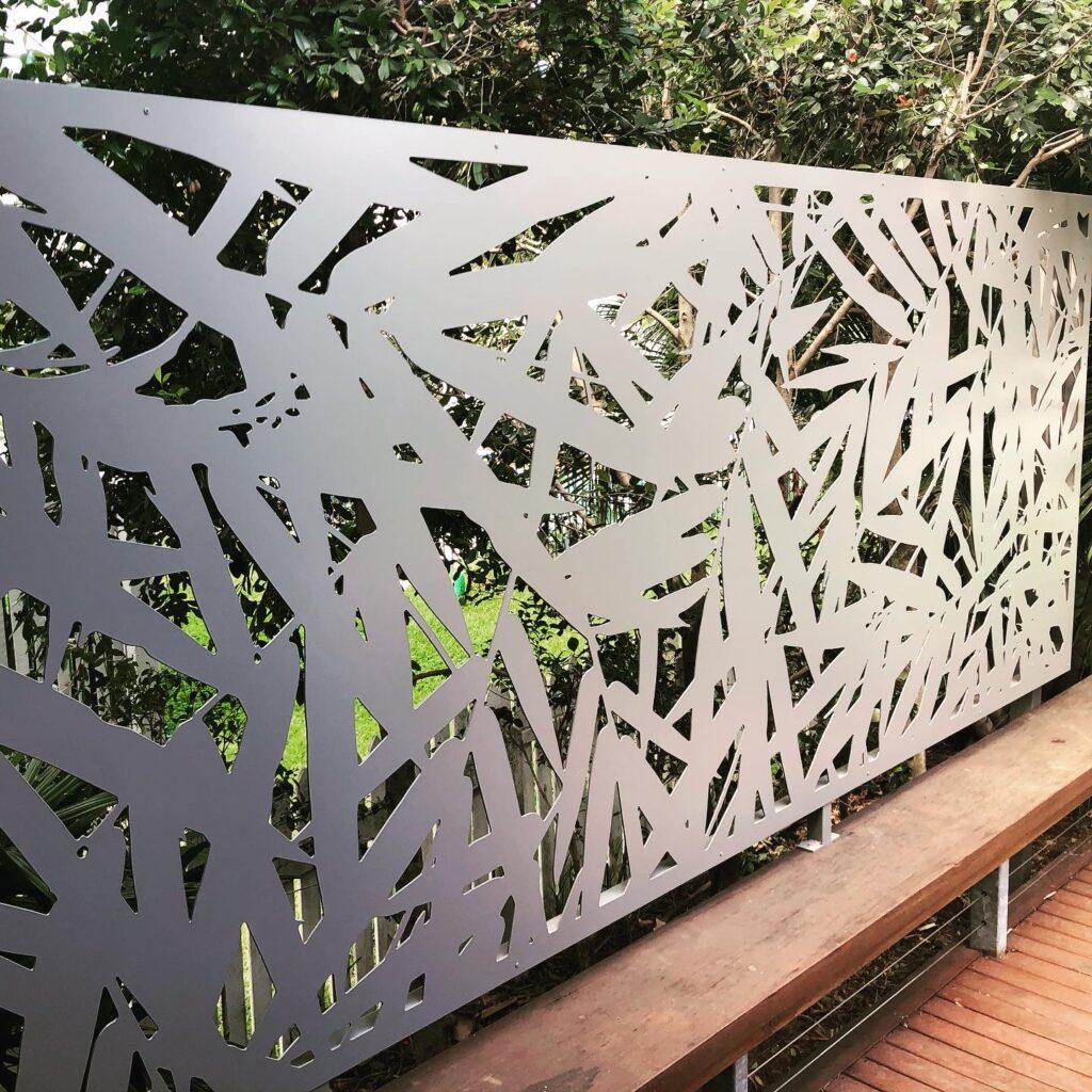 Decorative aluminium screen on a deck area