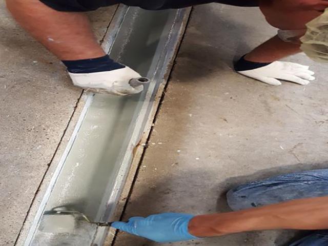 repairing gutter joint in concrete floor