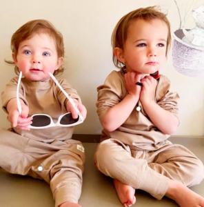 two babies in fashion gear