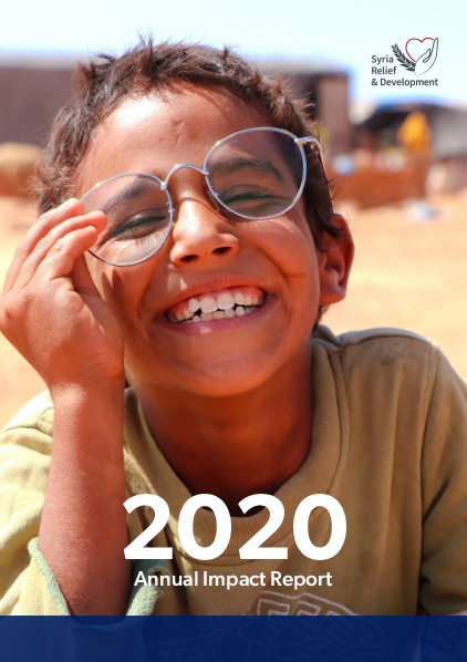 Cover of the 2020 Annual Impact Report, pictures a laughing boy wearing glasses