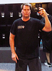 Tim at the gym. Note how the black clothing hides some of life's excesses!