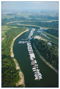 Aerial view of a marina with plenty of boats parked at its docks