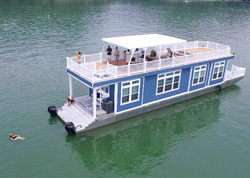 Blue houseboat with a spacious rooftop deck